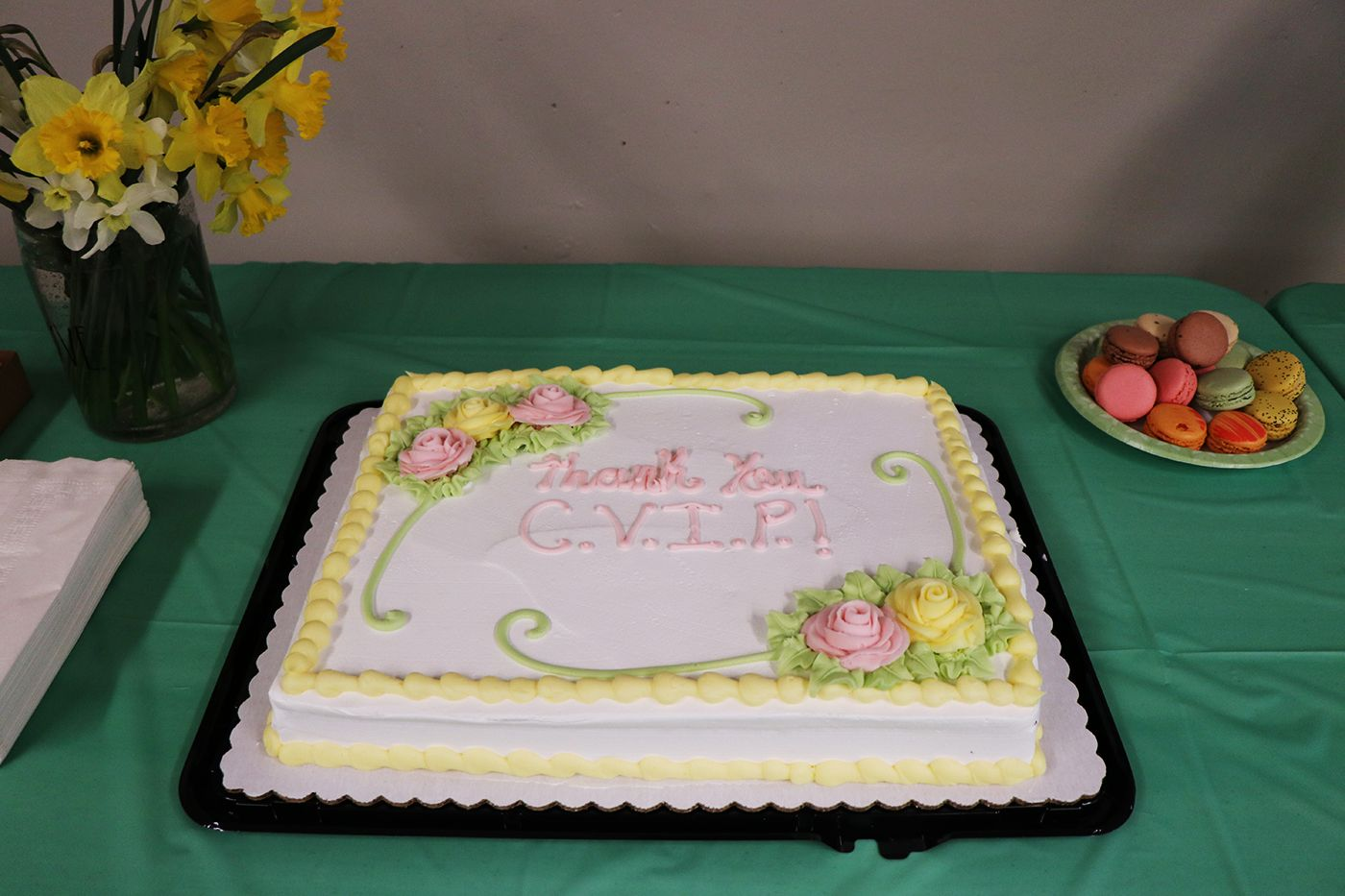 Bakery cake with the words Thank You CVIP written on it. Cake is on table for CVIP luncheon.
