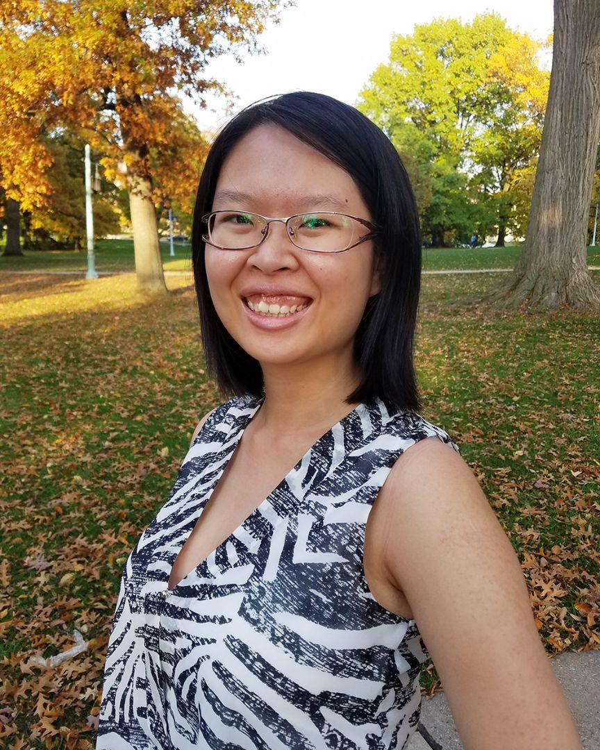 Yi Ting Chua outdoors, smiling at camera