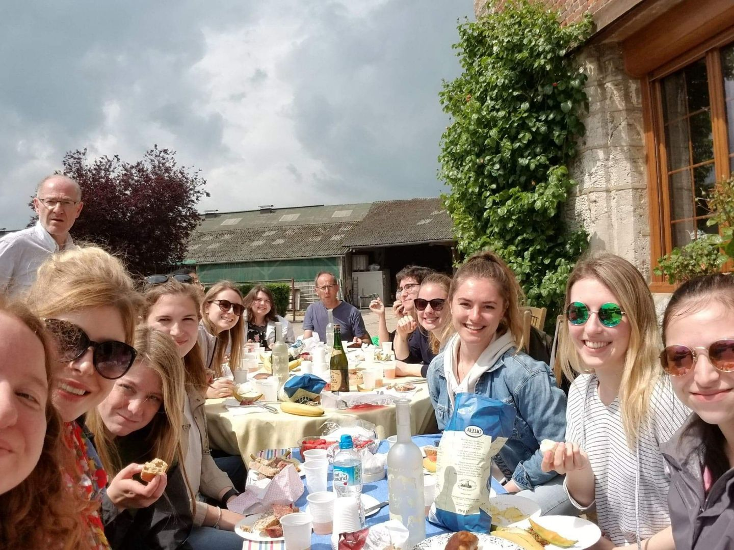 Group of students sitting outside at a restaurant in France