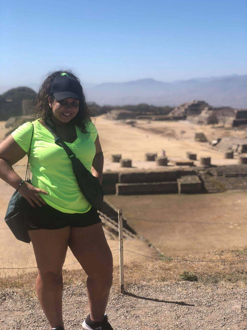 Arianna standing atop Mayen ruin in Mexico