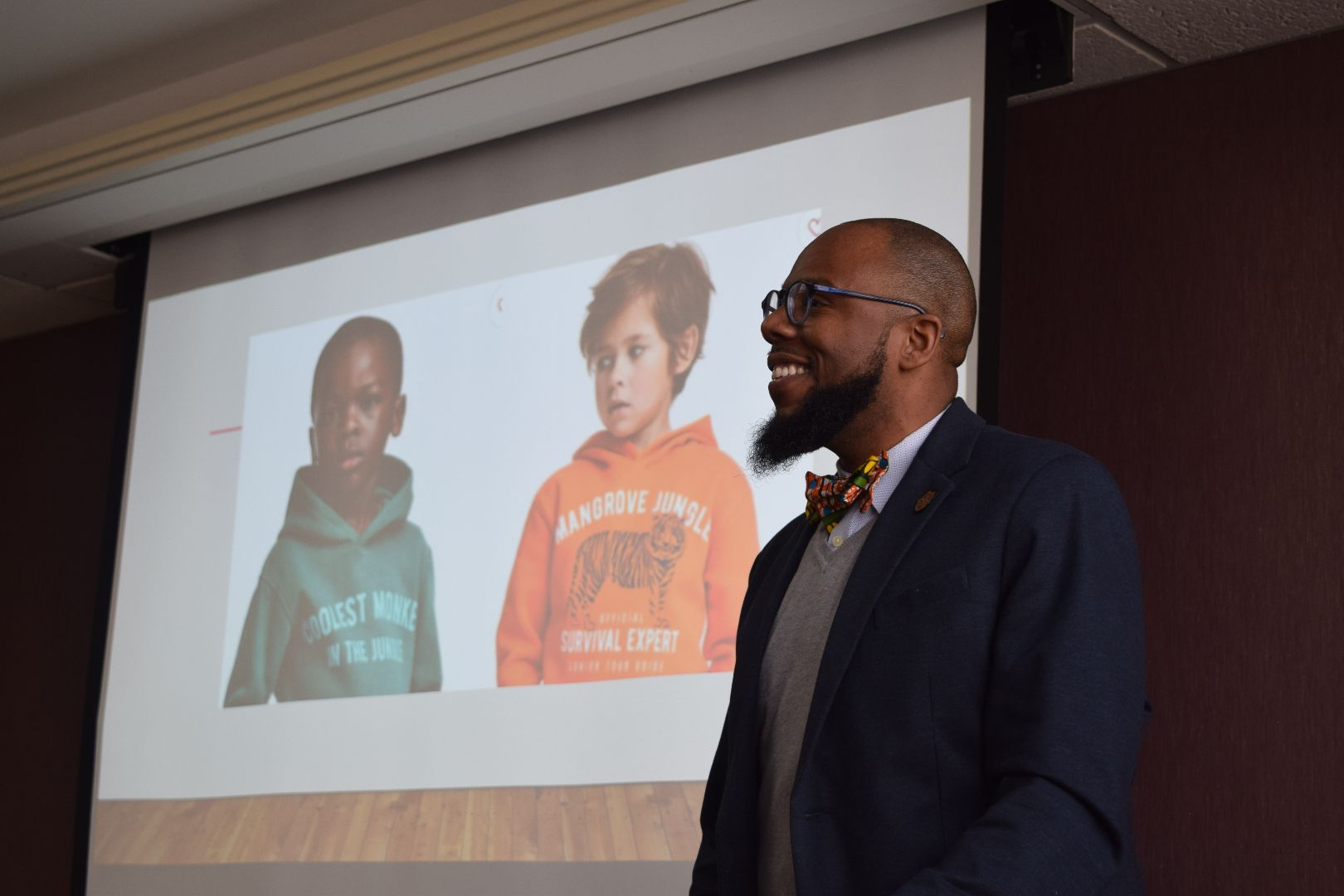 """Chezare presenting at his GenCen Colloquia, """"Meeting Myself: Race-Gender Oppression and a Genre Study of Black Men Teachers' Interactions with Black Boys."""""""