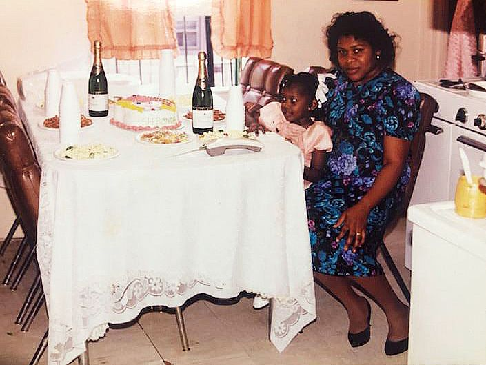 shewonda as a little girl sitting on chair with older woman who is her mother