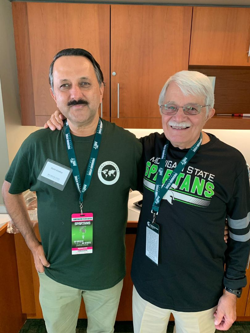 Rohit Khattar poses with friend David Horner, both are wearing Spartan gear jpg