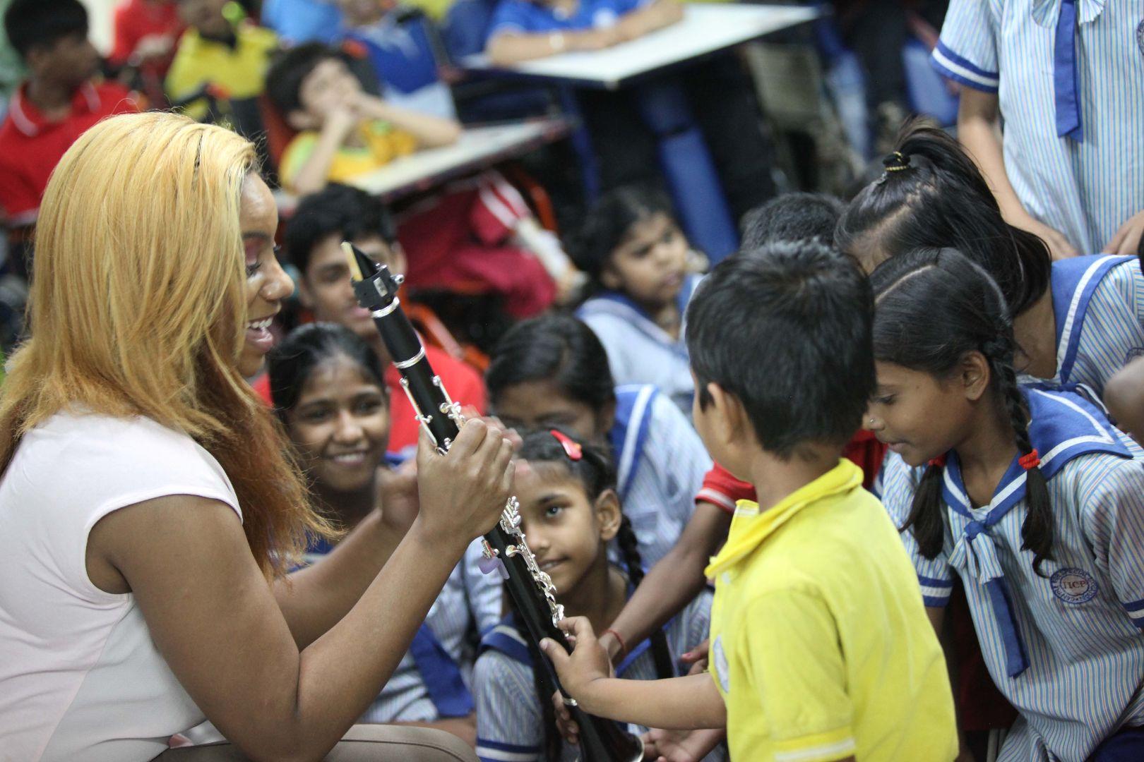 Marissa showing clarinet to local Indian children