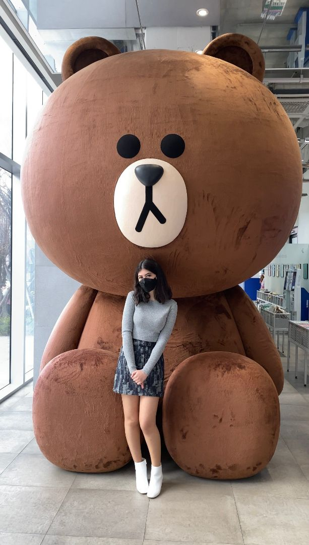 Daoud standing in front of giant teddy bear