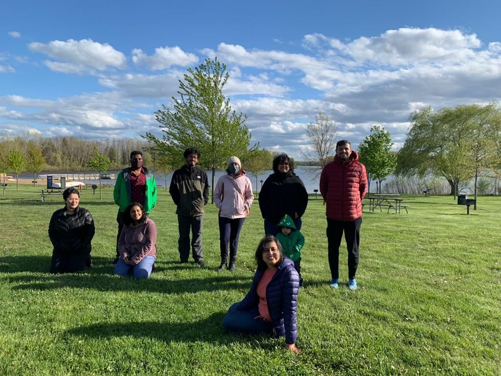 A group of Indian MSU students gather on a lawn.
