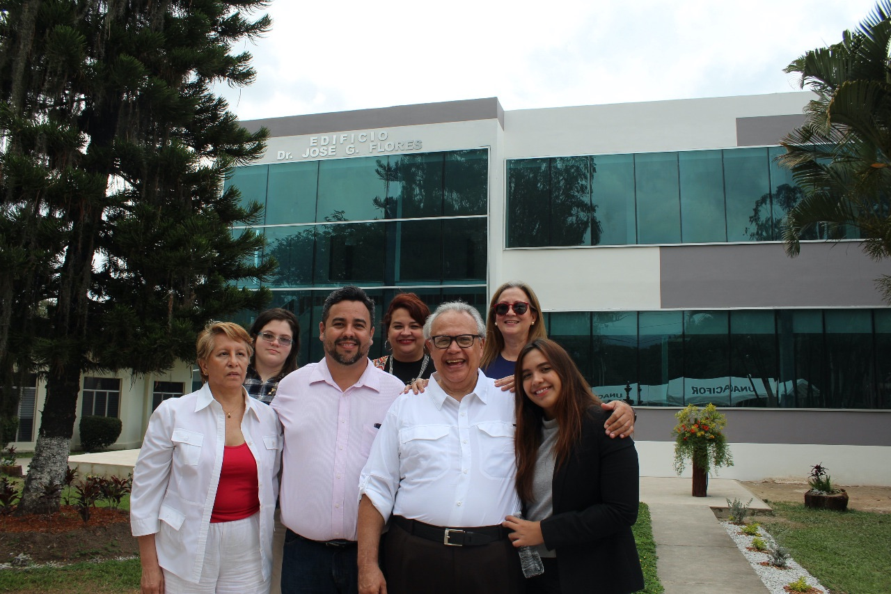José with family and friends in front of a building named after him at the National Forestry University of Honduras