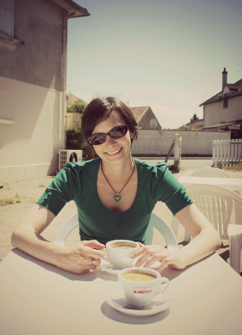 Rebecca Irvine sitting outside drinking coffee