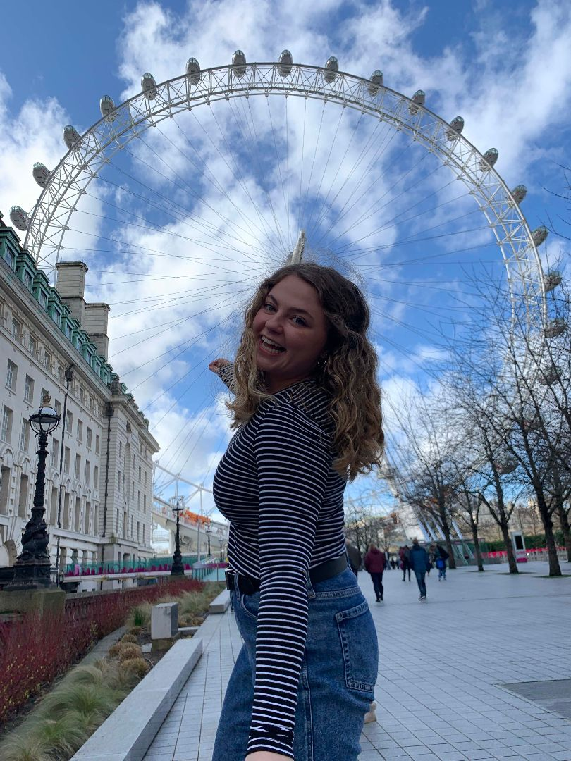 Maddie in front of the London Eye in England