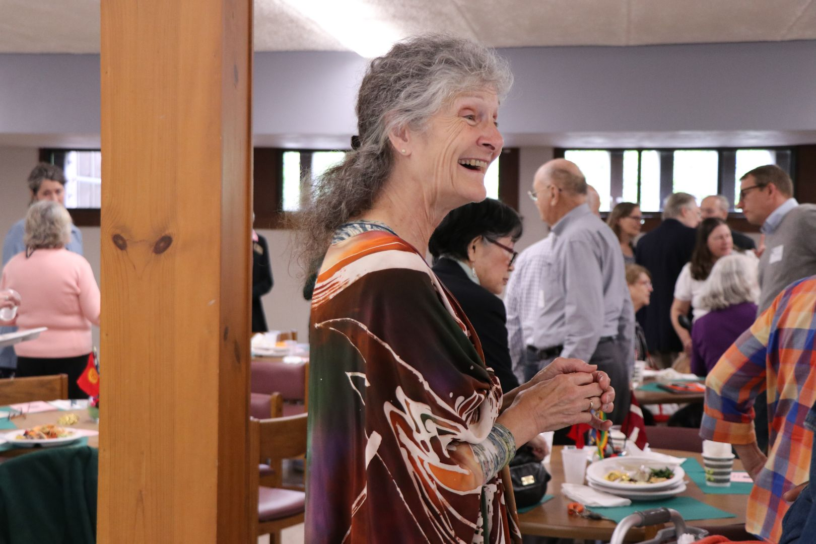 Marge Weldon CVIP, board member at CVIP luncheon. She is standing and smiling.