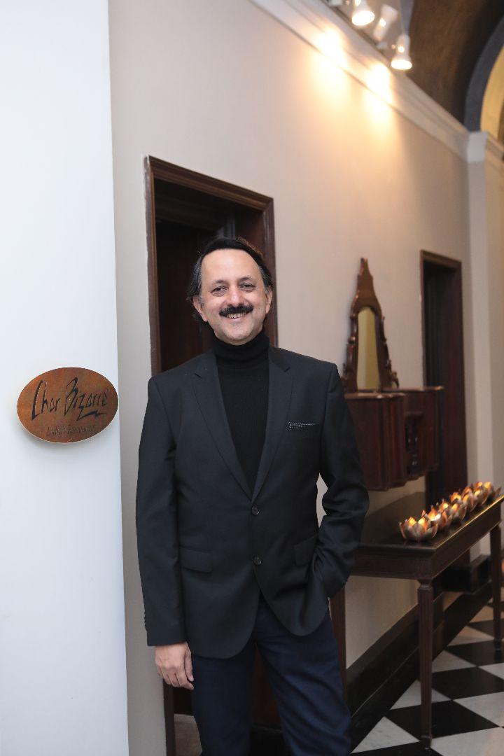 Rohit Khattar poses outside his restaurant Chor Bizarre