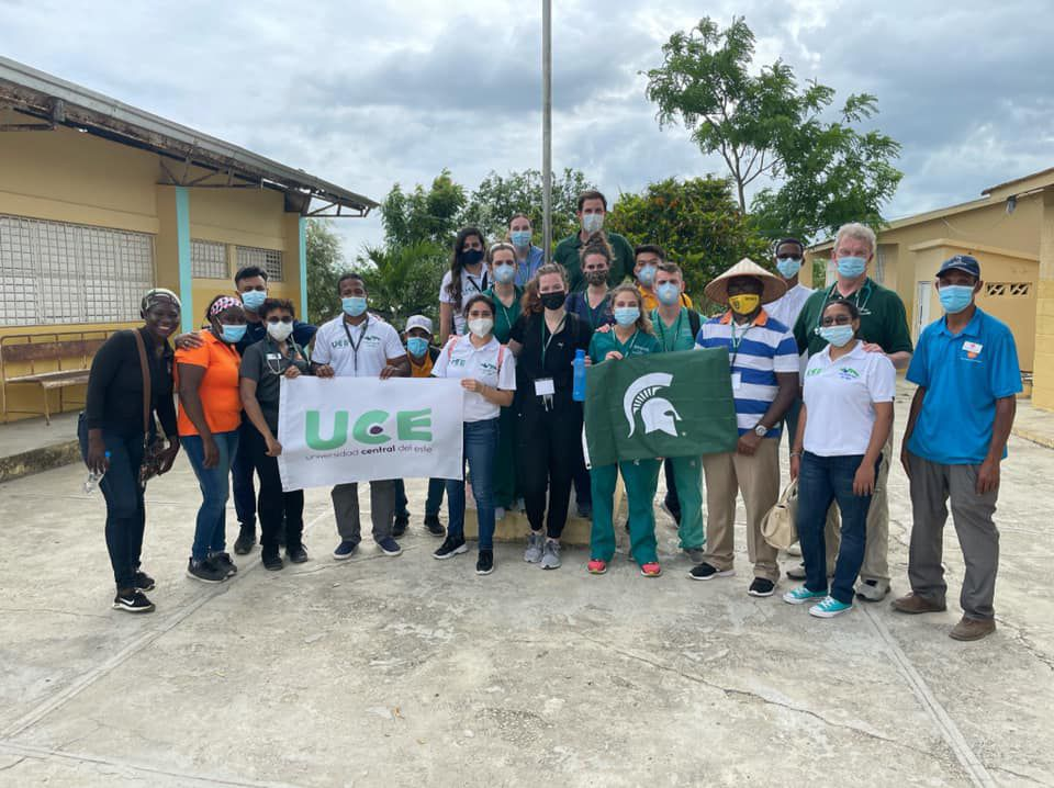 Group holding Spartan flag